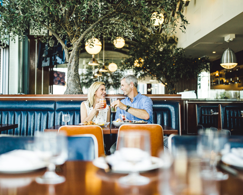 Couple dining inside
